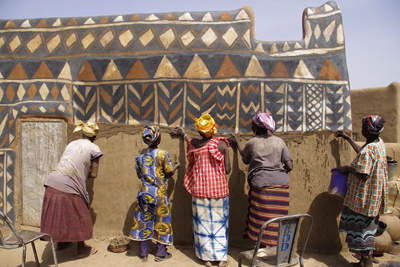 Painting the wall by women